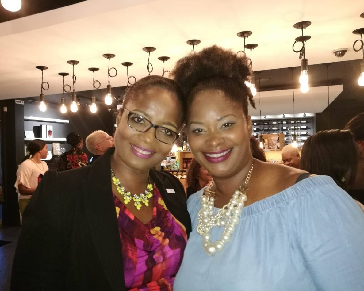 President of the Association of Female Executives of TT (AFETT) president (left) Yolande Agard-Simmons with AFETT's director of programmes Sherleen Young Griffith at AFETT's Social at Uncorked, Port of Spain in August 2017. PHOTO COURTESY AFETT.