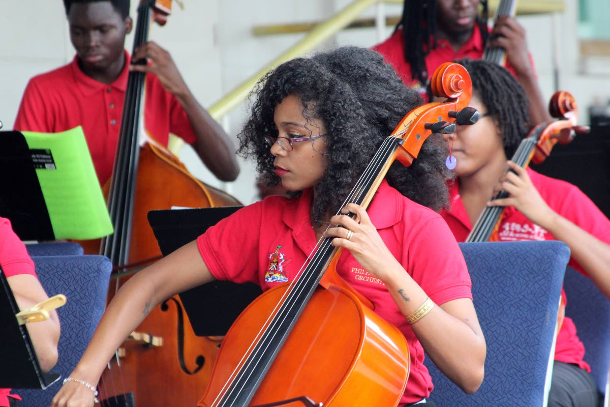 Members of the National Philharmonic Orchestra perform at the National Library,  Abercromby Street, Port of Spain.