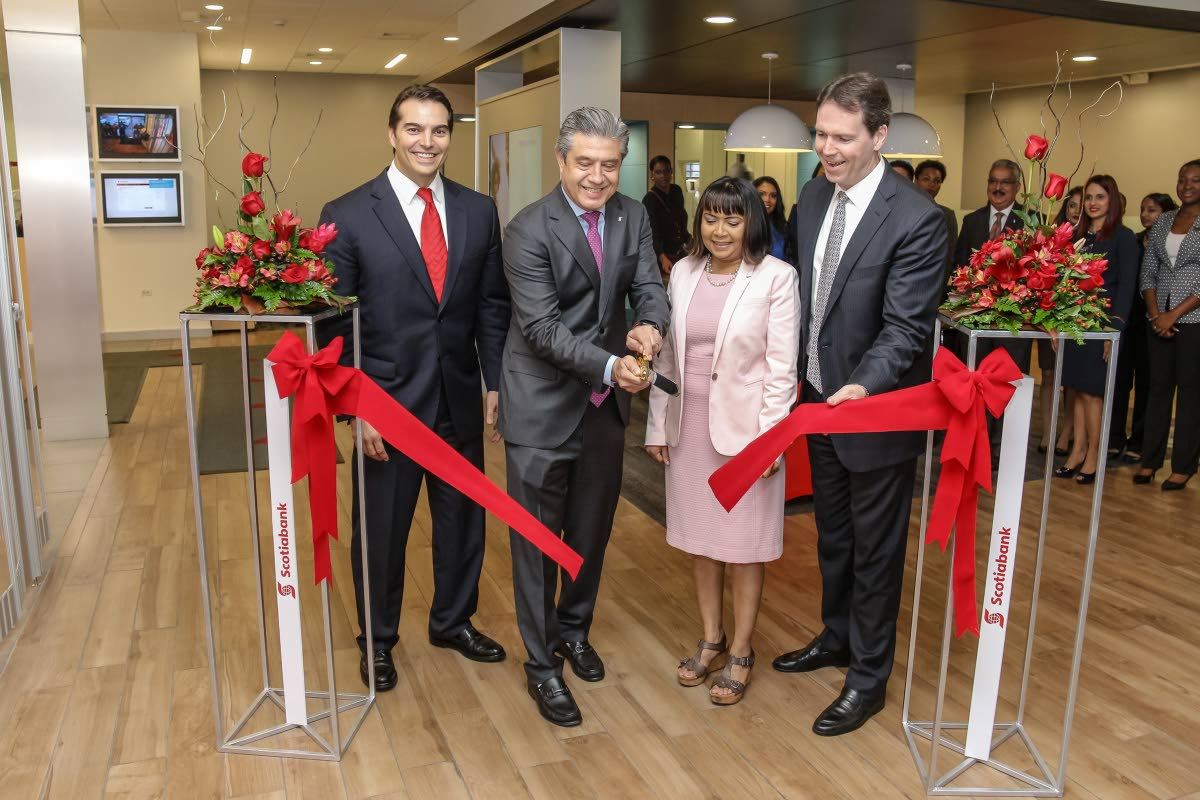 Scotiabank Managing Director Stephen Bagnarol; Ignacio Deschamps Group Head International Banking and Digital Transformation; Dr Sandra Sookram, Deputy Governor of teh Central Bank of TT; and Brendan King Senior VP International Banking cut the ribbon to officially open the bank's digital branch located in Price Plaza, Chaguanas. Photo by Jeff K Mayers