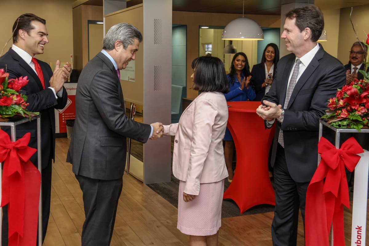 Ignacio Deschamps (second from left), Scotiabank group head international banking and digital transformation shakes hands with Dr Sandra Sookram, deputy governor of the Central Bank, as Scotiabank managing director Stephen Bagnarol (left) and Brendan King, senior vice president international banking look on at the official opening of the bank's digital branch. Photo by Jeff Mayers