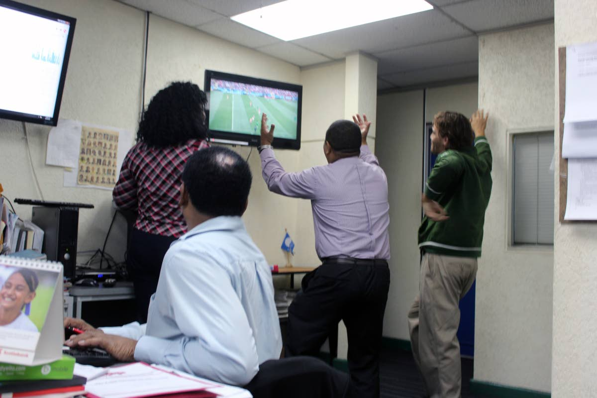 Workers took some time to watch the world cup game with Russia and Saudi Arabia today. Photo: Enrique Asson