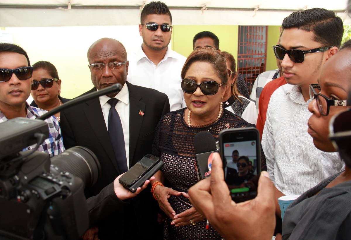 Opposition Leader Kamla Persad Bissessar surrounded by opposition MP's and councillors speaking to reporters after the funeral service for Eric Ganesh, which took place at St. Charles Village Princes Town. PHOTO BY ANIL RAMPERSAD.