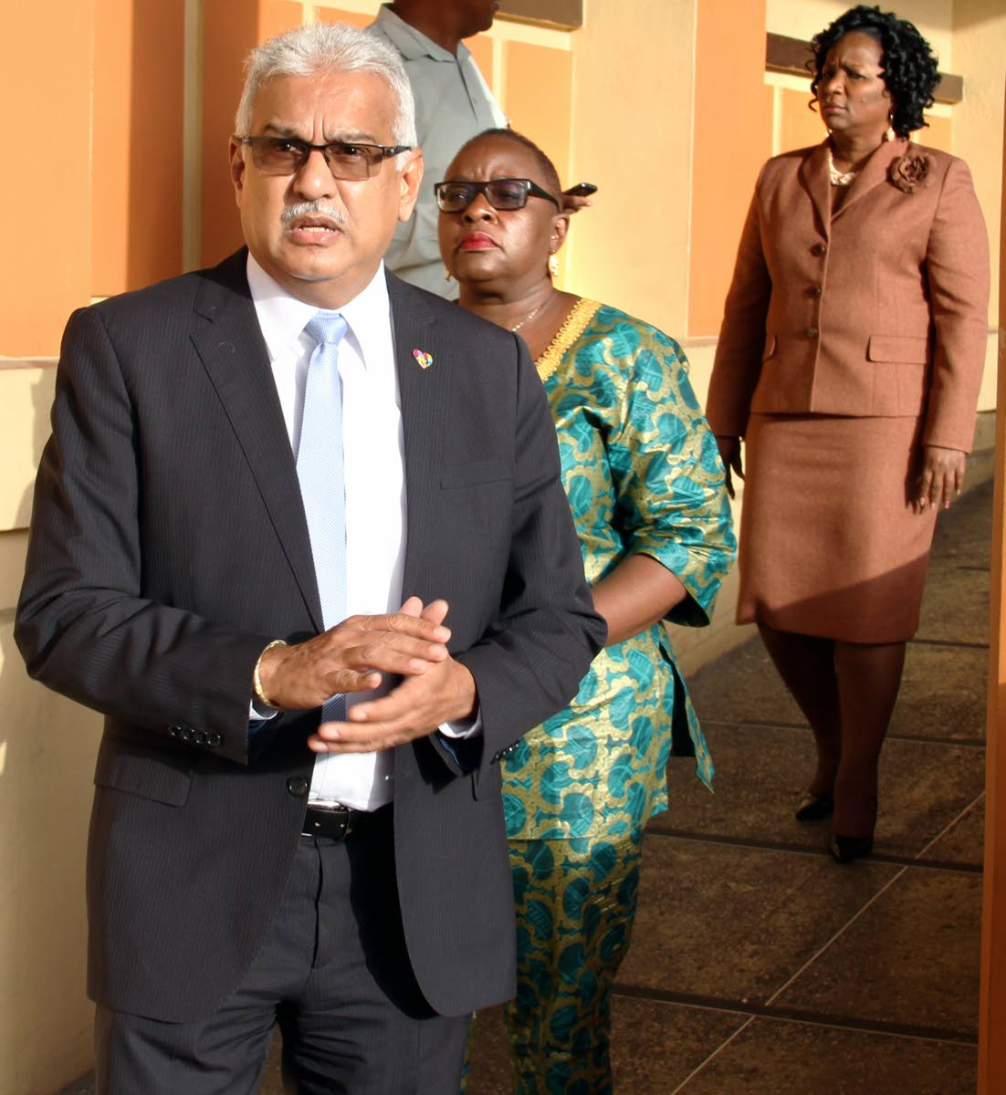 WORRIED MINISTERS: Health Minister Terrence Deyalsingh, Planning and Development Minister Camille Robinson-Regis, centre, and Social Development and Family Service Minister Cherrie-Ann Crichlow-Cockburn at the Port of Spain General Hospital yesterday where they visited their ailing colleague Marlene McDonald. PHOTO BY SUREASH CHOLAI