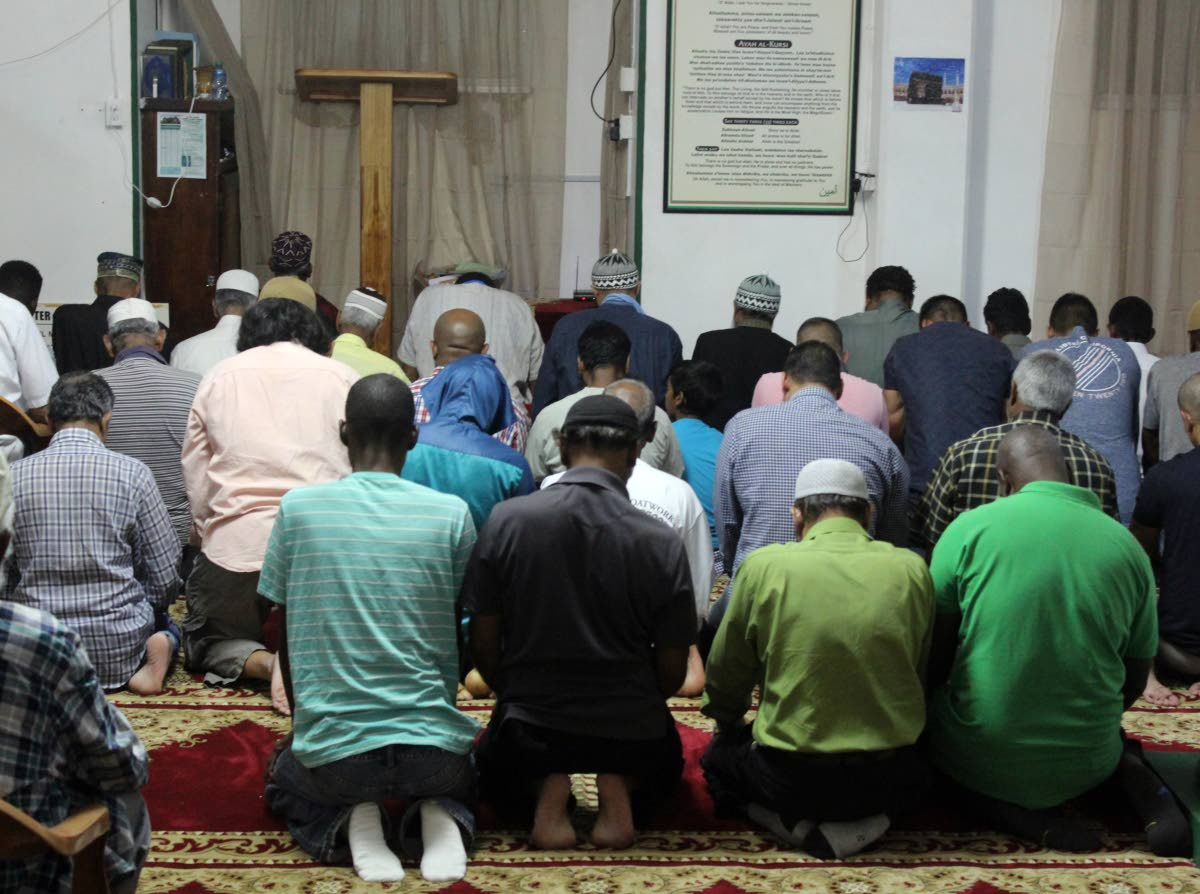 THIS IS OUR FAITH: Members of the St James mosque pray yesterday evening after  breaking fast. PHOTO BY ENRIQUE ASSOON