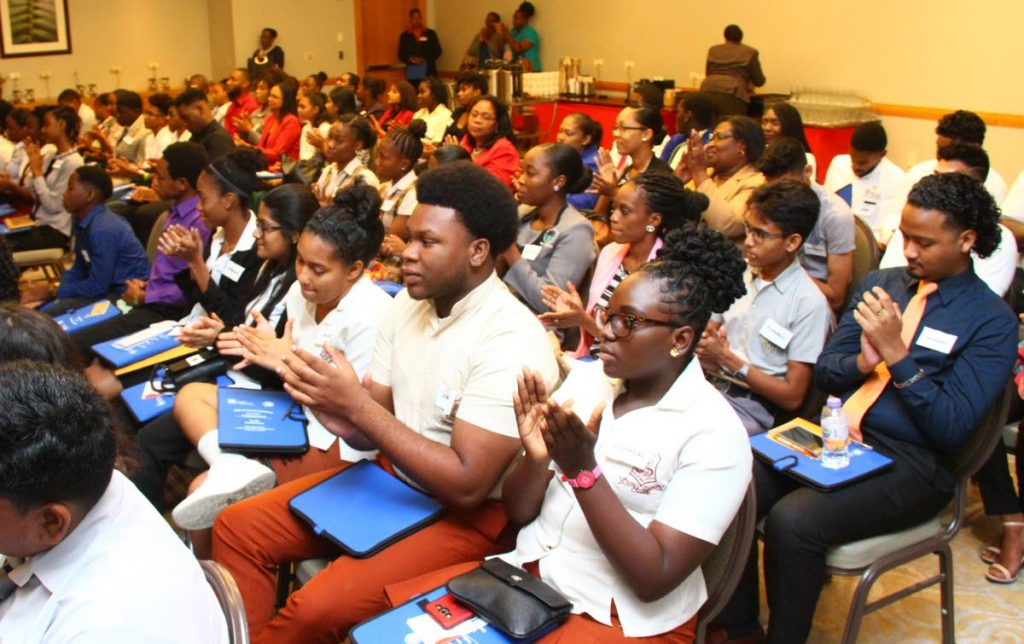 Warm reception: Speakers receive a warm response from participants at the youth conference of the Caribbean Confederation of Credit Unions convention, Hyatt Regency, Port of Spain yesterday. PHOTO BY ROGER JACOB