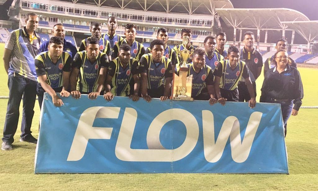 Shiva Boys Hindu College players and coaching staff celebrate after winning the Flow SSCL T10 title with Cindy Ann Gatt, director of marketing at Flow, and officials of the SSCL.