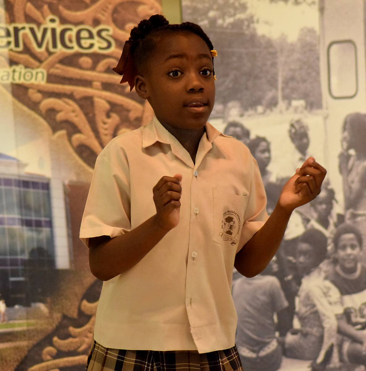 Kwanice Mc Clean, of Mt St George Methodist Primary School, tells the story of Monkey and Alligator at the finals of the Tobago Library Services/ Republic Bank Ltd's 3rd Annual Storytelling Competition at the Anne Mitchell-Gift Auditorium, Scarborough Library last Thursday.