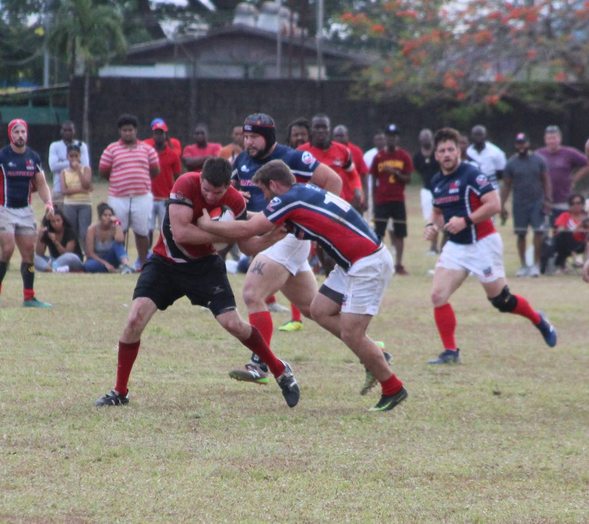 TT's Gordon Dalgliesh, left, is tackled by USA South's Patrick Audino in a RAN Men's 15s match at St Mary's Ground, St Clair, Saturday.