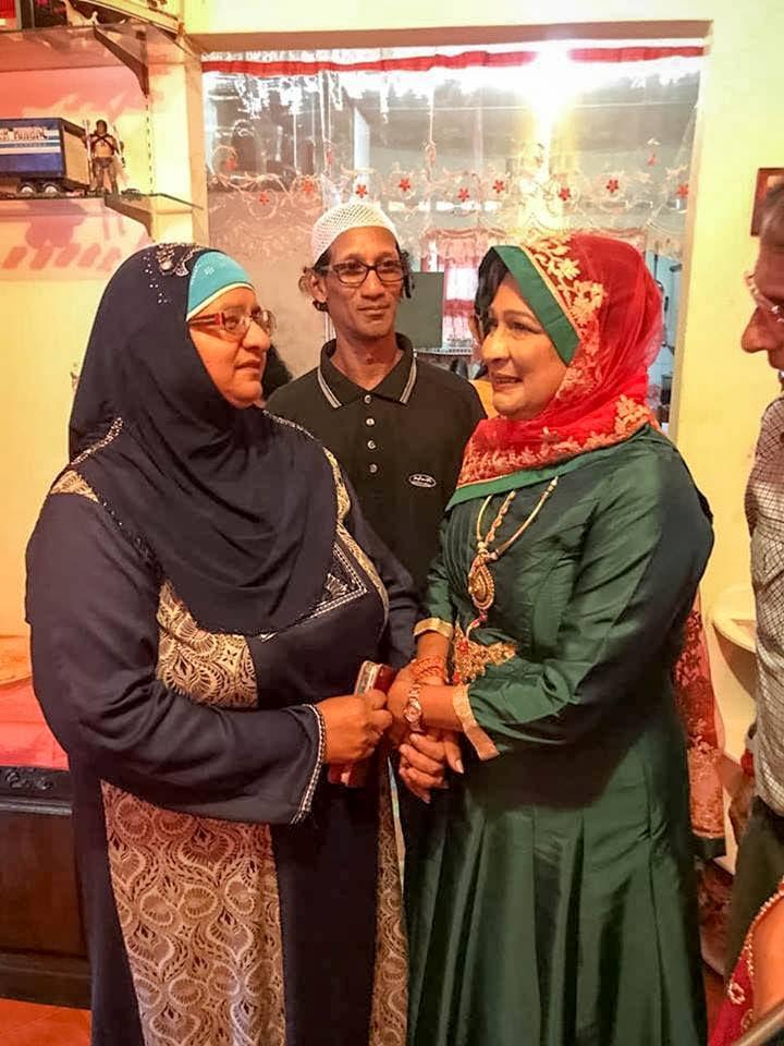 Eid visit: Opposition Leader Kamla Persad-Bissessar, right, speaks with former PNM deputy leader Nafessa Mohammed on a visit to her home in Mohammedville, El Socorro for Eid on Friday. Source: Kamla Persad-Bissessar Facebook page