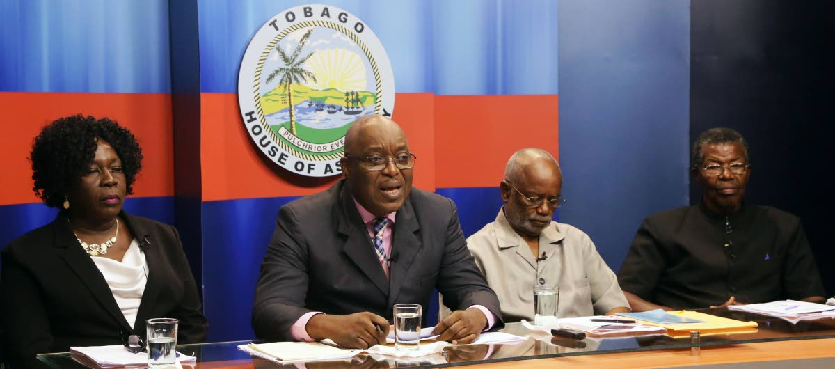Chief Secretary Kelvin Charles, second from left, speaks at a press conference last Thursday on the Tobago autonony bill at the Administrative Complex.  Others in photo are Ingrid Melville, legal advisor to the Forum, Stanford Callender, chairman  of the Tobago Council of the PNM, second from right, and Hochoy  Charles, political leader of the The Platform of Truth (TPT), and a former THA chief secretary.