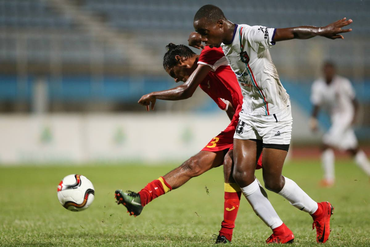 Point Fortin Civic's Justin Sadoo shoots to score as Morvant Caledonia United's Jomokie Cassimy, right, defends in their First Citizens Cup clash at the Ato Boldon Stadium, Couva, Saturday.