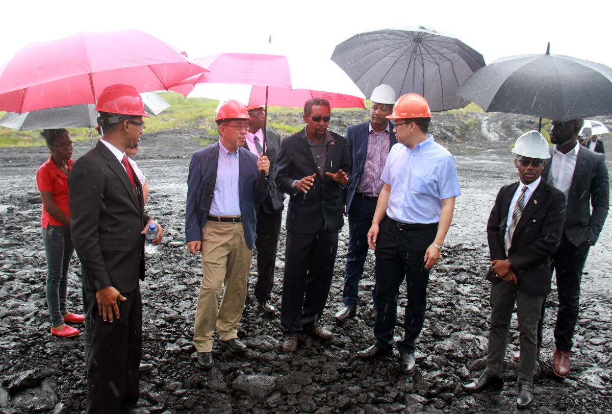 Members of the Chinese delegation and members of Lake Asphalt TT management team tour the La Brea pitch lake.