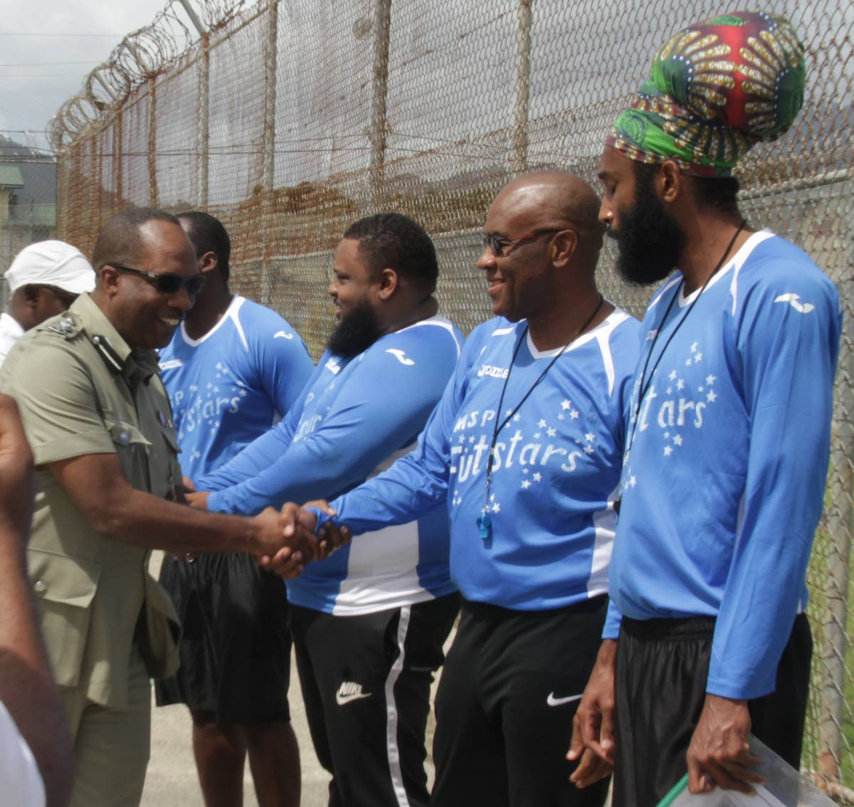 The Futsal programmes is one of acting  Commissioner of Prisons Gerard Wilson's favourite success stories. Above, Wilson greets members of the MSP FUTstars team, comprising of players and coaches at the introduction of the game of Futsal to inmates of the Remand Prison at Golden Grove Prison Facility, Arouca in March.