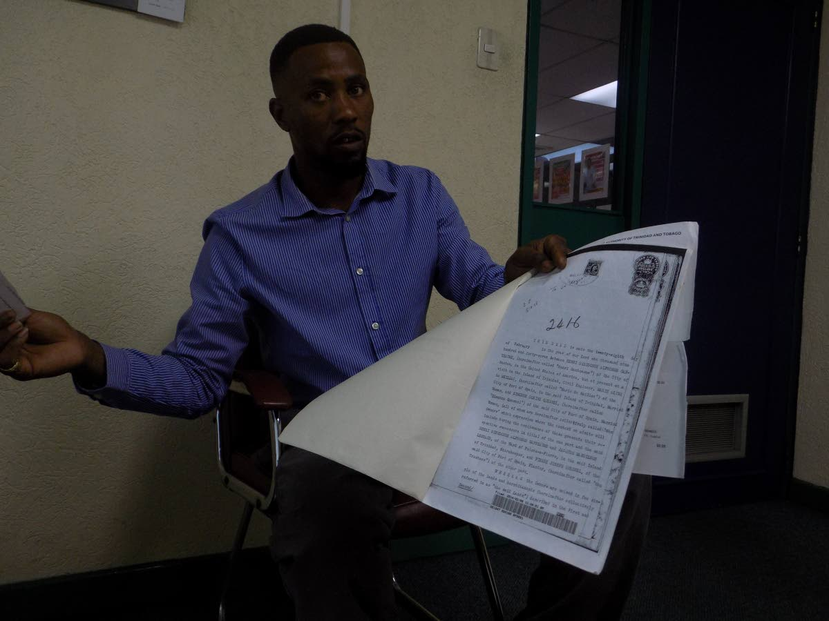 34-year-old Marvin Ganteaume holds a copy of what he says is a deed dating back to the early 20th century, granting his ancestor the right to property in St Joseph.  Ganteaume claims he is the descendent of the Gantreaume family, French plantation owners who settled in Mayaro during the 18th century.