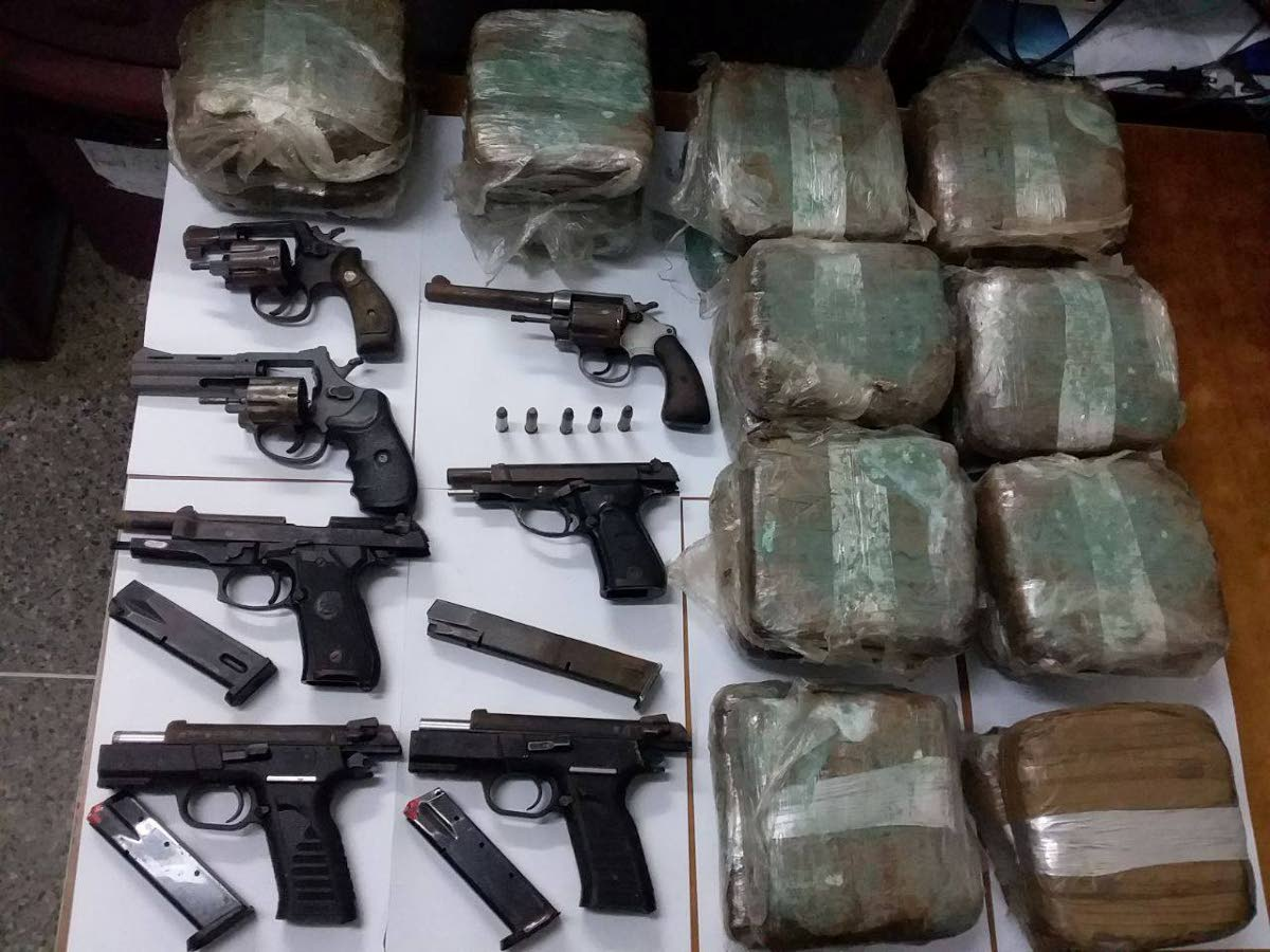 SEIZED: Guns and marijuana seized at a beach in Cedros on the weekend by police.