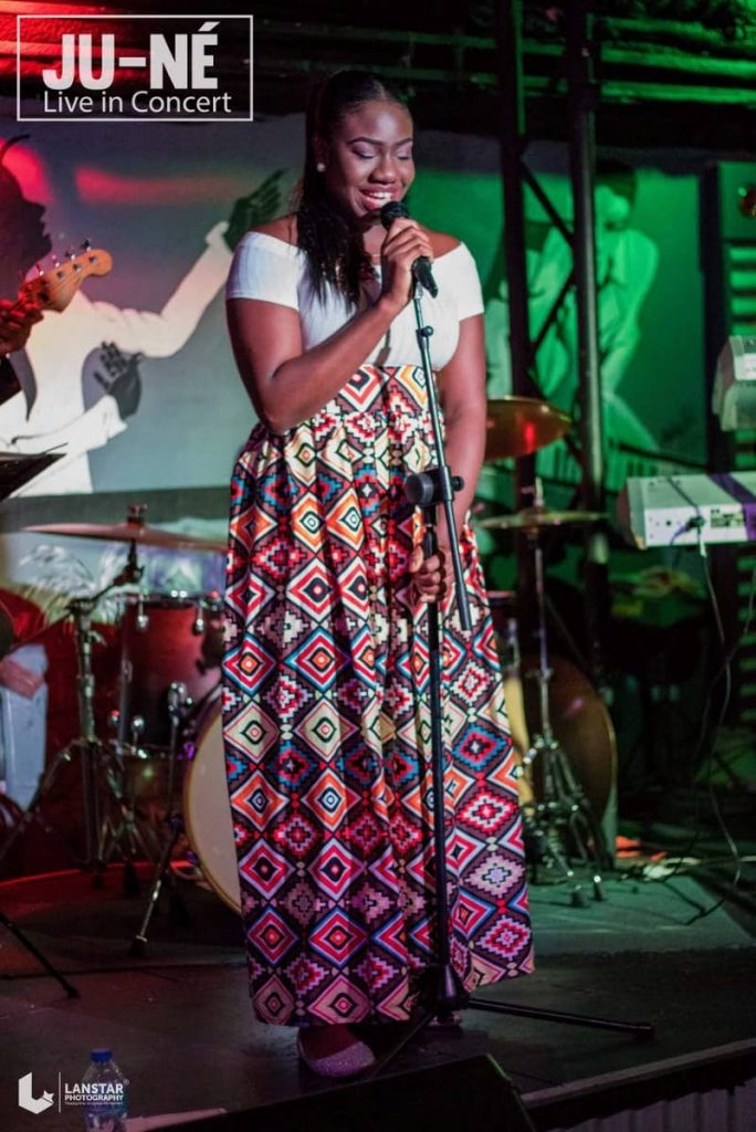 Ju-ne Thomas, singer and songwriter of Calder Hall, performs at a concert.