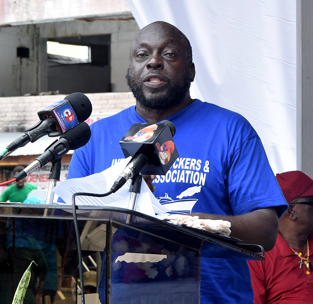 Horace Amede, President of the Inter-isle Truckers and Traders Association speaks at the First Historic Labour Day march in Tobago, attended by member unions of the National Trade Union Centre of TT (NATUC), at James Park on Tuesday, Labour Day.