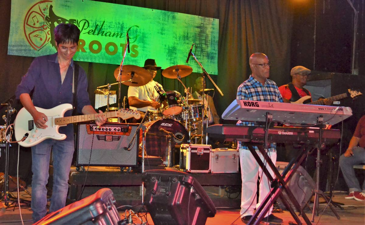 Pelham Goddard and Roots on stage.