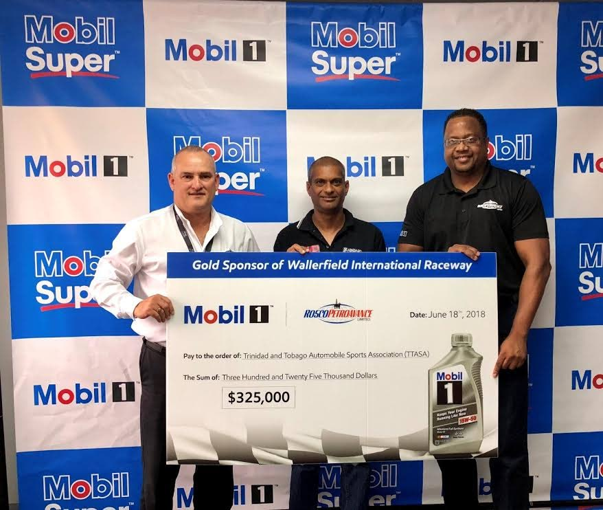 Vice president of TT Automobile Sports Association (TTASA) Jameer Ali, centre, receives a $325,000 sponsorship cheque from  Rosco Petroavance Ltd CEO Wayne Bernard, left, and division manager (Mobil Lubricants) for Rosco Petroavance Ltd, Eugene Sylvester.