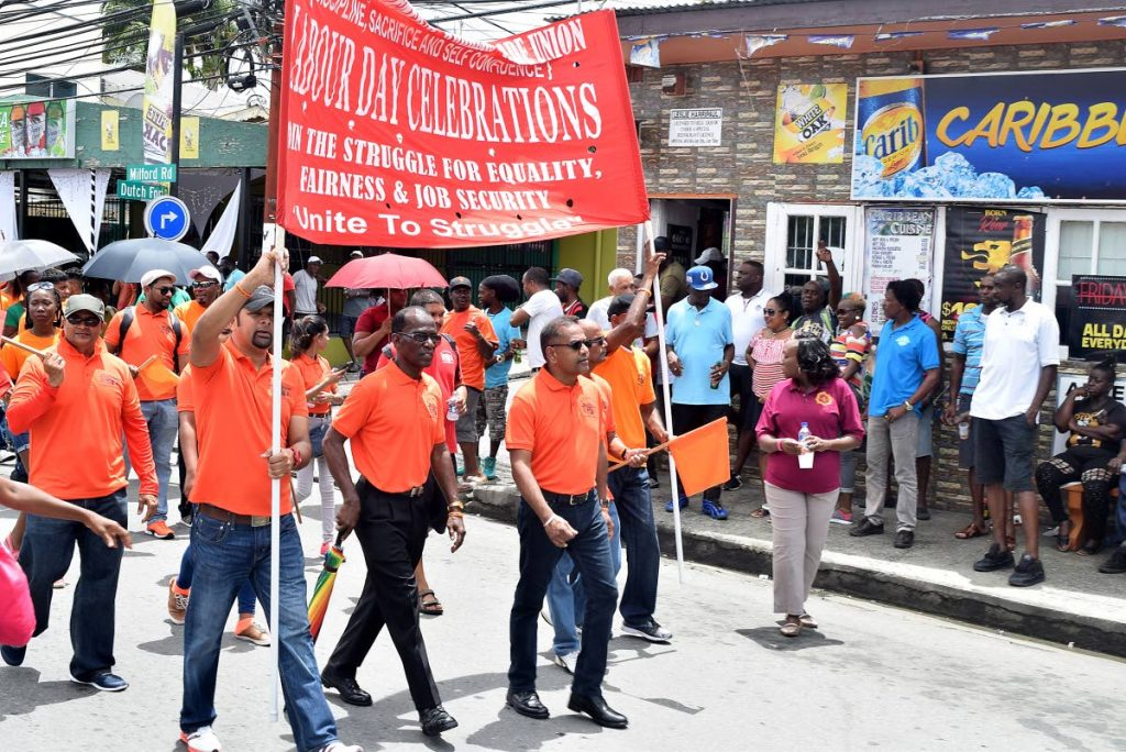 "Members of All Trinidad General Workers Trade Union (ATGWTU) make their way through the streets of Scarborough on Tuesday, during the National Trade Union Centre's historic march and rally, commemorating ""142 years of labour struggle"" in Tobago."