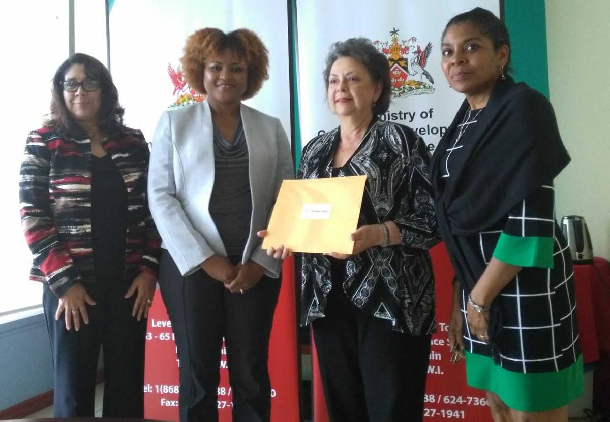 ON BOARD: Mas woman Rosalind Gabriel (third from left) receives her letter of appointment to the NCC board from Culture Minister Dr Nyan Gadsby-Dolly (second from left).  Also in photo are permanent secretary Angela Edwards (left) and deputy permanent secretary Susan Shurland.