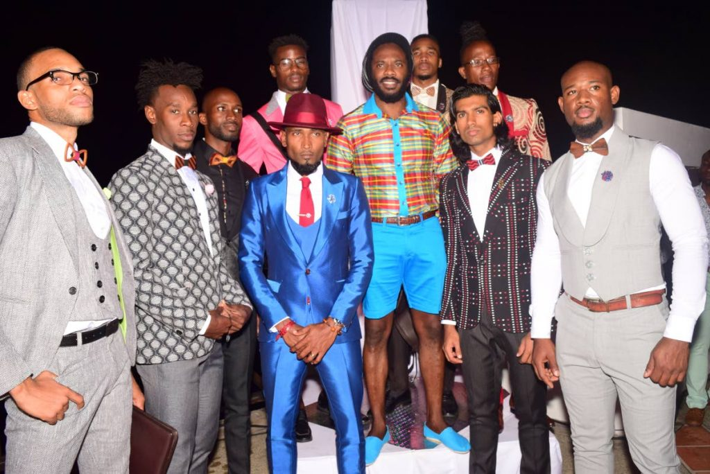 Designer Marlon George, owner of DAWW Creations, centre, is surrounded by some of his models at Leve-Global's Love Is In The Air lifestyle extravaganza at Villa Being, Arnos Vale, Tobago, recently. PHOTOS BY VIDYA THURAB