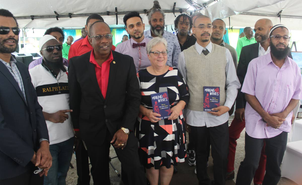 Lessons learnt: Commissioner of Prisons Gerard Wilson, third from left, with Debbie Jacob, centre, and her history students at the launch of her book Making Waves: How the West Indies Shaped the US, at the Port of Spain Prison yesterday. PHOTO BY ENRIQUE ASSOON