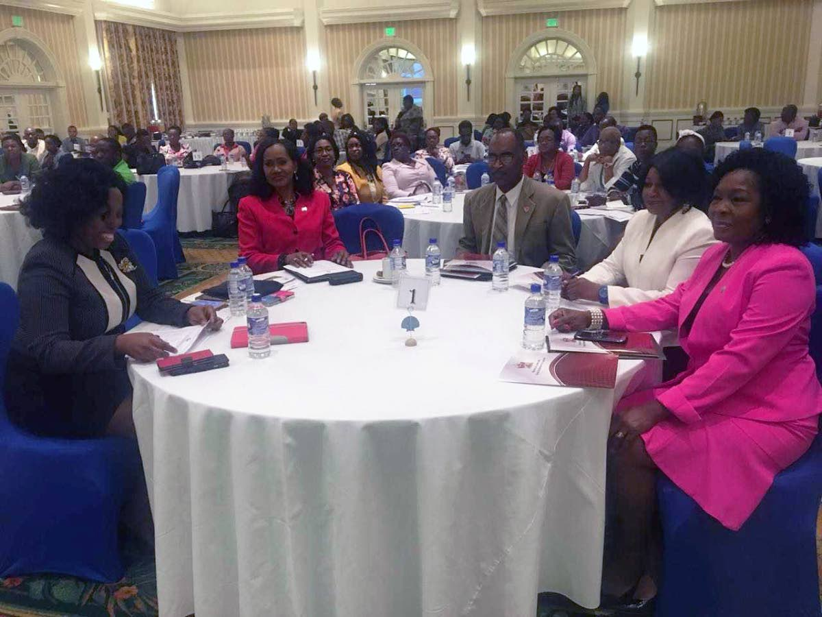 LET'S TALK IT OUT: Labour Minister Jennifer Baptiste Primus, seated 2nd from left, at a National Stakeholder Consultation on the Draft National Workplace Policy on Sexual Harassment at the Magdalena Grand Beach and Golf Resort. PHOTO BY KINNESHA GEORGE-HARRY