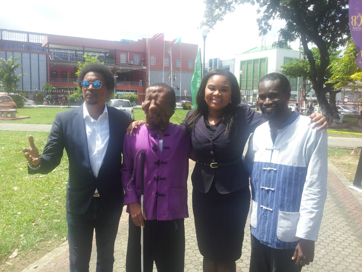 Visually impaired martial arts athlete Shawn Sealy of Barbados, second from left, at the Olympic Day celebrations at Woodford Square, on Friday. Also in the photo are president of the TT Olympic Committee Brian Lewis, left, Minister of Sport and Youth Affairs Shamfa Cudjoe, second from right, and Sealy's coach Erskine Husbands.
