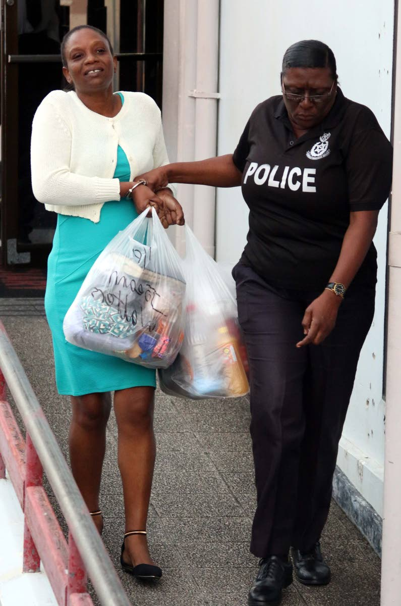 OFF TO JAIL: Joeann Walters is taken out of the San Fernando High Court yesterday to begin serving time for possession of gun, ammunition and marijuana for the purpose of trafficking.   PHOTO BY ANSEL JEBODH