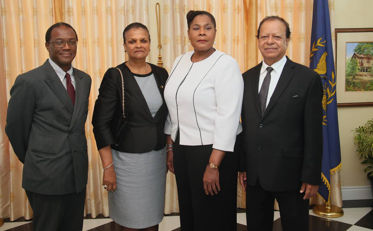 NEW SILK: President Paula Mae Weeks (second from right) with newly sworn in Senior Counsels (from left) Ian Benjamin, Ruth Van Lare and Kemrajh Harrikissoon at the President's Cottage, Port of Spain.