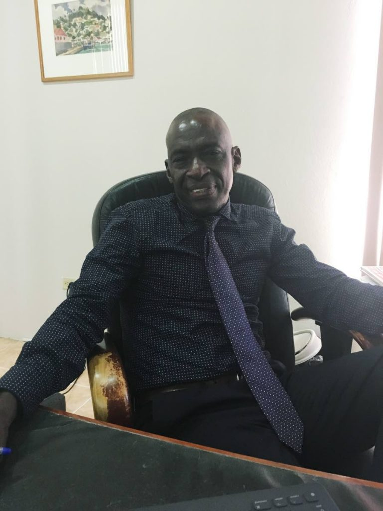 NLCB chairman Eustace Nancis, at his office in this February 23 file photo, says a NLCB $1.5 million contract for social media services has been cancelled after questions about the way it was awarded arose.