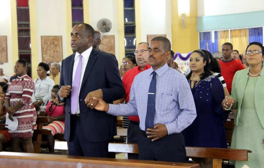 Dominica Prime Minister Roosevelt Skerrit, left, and his Minister of Education Pettar Saint-Jean during a mass at St Theresa's RC Church, Barataria on November 25, 2017 in thanksgiving for all the help the island received after the devasation of Hurricane Maria. Dominica is bracing for Tropical Storm Beryl which was downgraded from a hurricane. PHOTO BY SUREASH CHOLAI