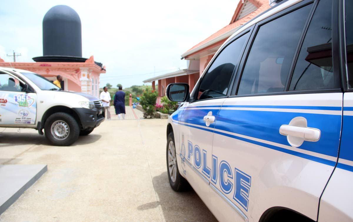 Cops on a robbery scene in Freeport in May. A Freeport couple was robbed twice by bandits days apart last week. FILE PHOTO