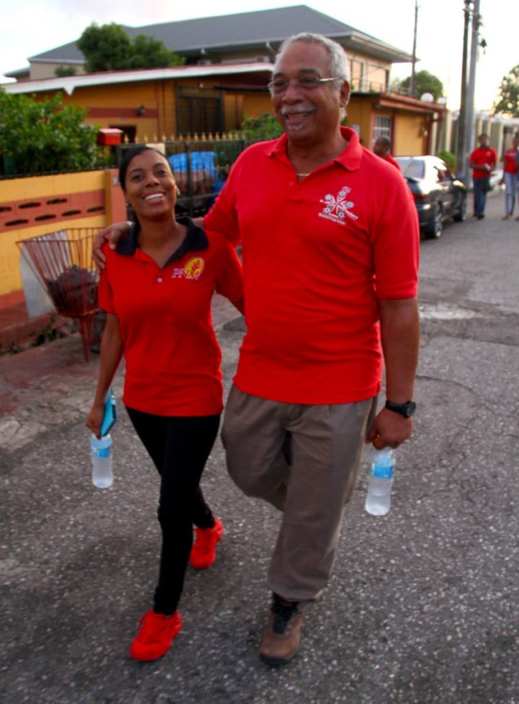 PNM Barataria candidate Kimberly Small with her father, Raymond Small, during a walkabout on June 21. PHOTO BY ROGER JACOB