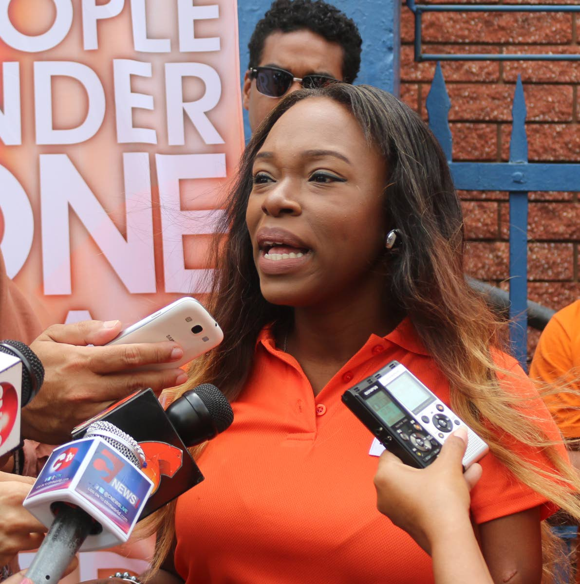 PEP candidate for Belmont East Felicia Holder answers reporters questions in Port of Spain on nomination day, June 25.  PHOTOS BY XAVIER SYLVESTER