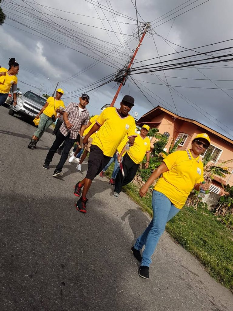 Sharon Maraj-Dharam, the UNC Barataria councillor-elect is seen leading supporters on a walks through prior to last Monday's by-election.