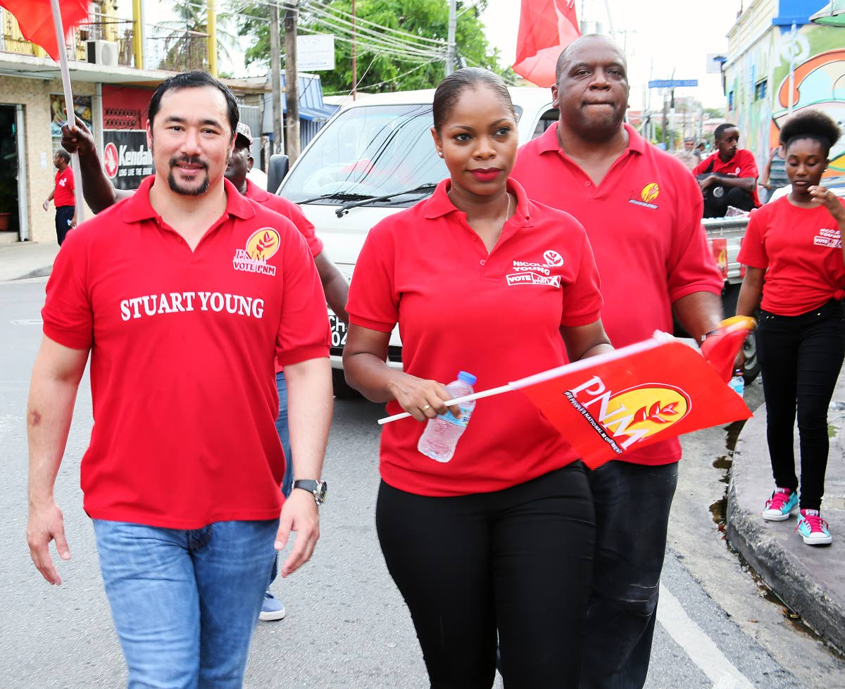 PNM Belmont East candidate Nicole Young accompanied by Minister of Communications Stuart Young, also PoS North/St Ann's West MP, on a walkabout in Belmont on June 30. PHOTO BY AZLAN MOHAMMED