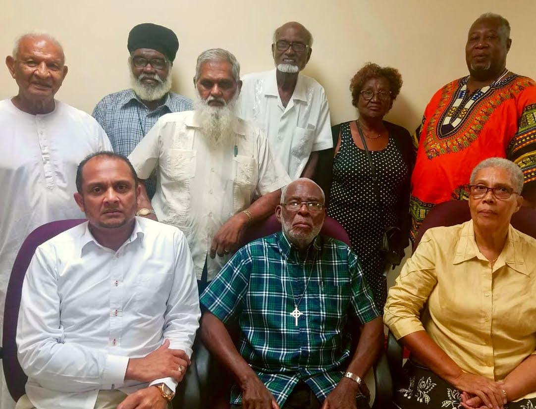 The IRO executive members are, seated left to right, Pundit Lutchmidath Persad Maharaj, Dean Knolly Clarke, president, Mother Joan Irish, back left to right, pundit Bramdeo Maharaj, Brother Hues, Pandit Mukram Sirju, Haji Noble Kahn, Abbess Jermaine Jordan and Baba Neil Ryan Rawlins.