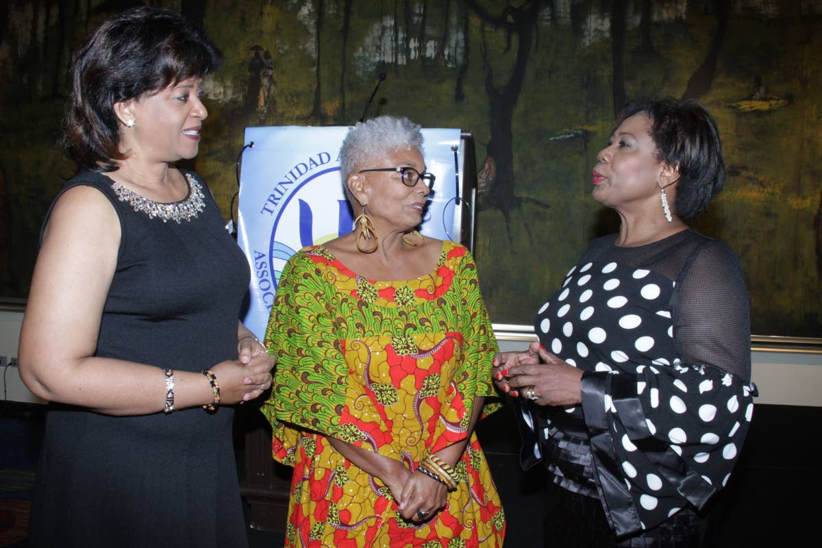DISCUSSING MENTAL HEALTH: House Speaker Brigid Annisette-George (right) speaks with TT Association of Psychologists president Dr Margaret Nakhid-Chatoor (left) and newly inducted honourary member Anna Maria Mora at the Trinidad Hilton yesterday.   PHOTO BY ROGER JACOB