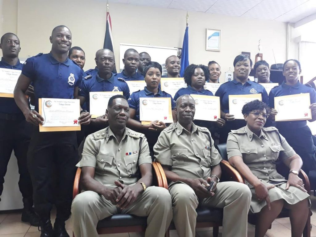 Members of the Tourism-Oriented Policing Unit, standing, pose with their Certificates of Excellence earned for good performance during the 2017/2018 cruise ship season. Seated in the front for a group photo with the officers are, from left, are Superintendent Sterling Roberts, Assistant Commissioner of Police, Garfield Moore, and former Senior Superintendent Joanne Archie (now ACP, Southern Division). The officers were honoured at a function on Monday at the Scarborough Police Station.