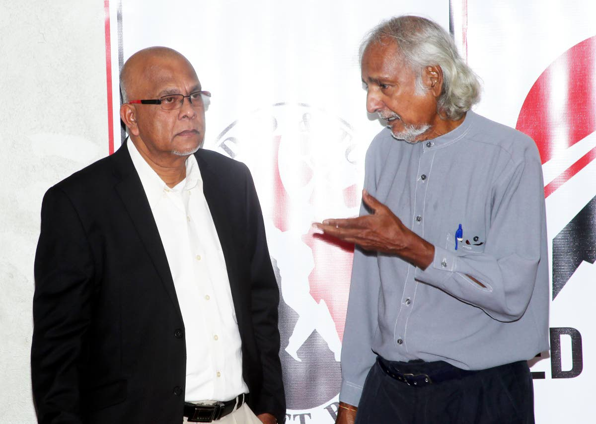 TTCB president Azim Bassarath, left, chats with vice president Dr Allen Sammy at a press conference last week at the National Cricket Centre, Balmain, Couva.