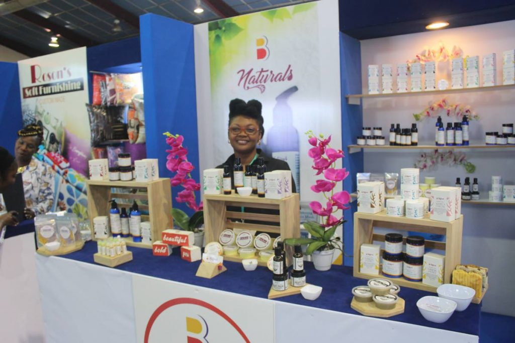 B Naturals' owner and Tobago resident, Mijanou Charles, proudly displays her health and beauty products at TIC 2018. PHOTO BY ENRIQUE ASSOON. July 5, 2018