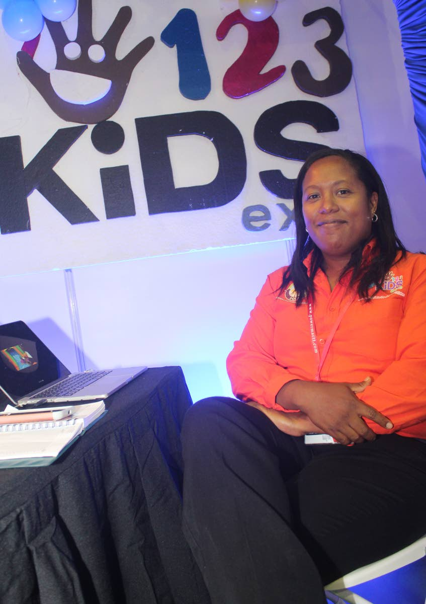 Kaisha Lee A Ping-Alfred, CEO of Trendy Trade Show Company and show director of 123 Kids Expo, seated in the 123 Kids Expo booth at TIC 2018. PHOTO BY ENRIQUE ASSOON. July 5, 2018