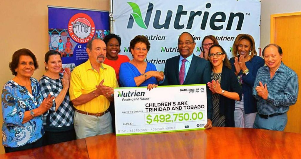 PARTNERSHIP: Simone de la Bastide, president of The Children's Ark receives a cheque from Nutrien  managing director Ian Welch last Thursday at The Children's Ark boardroom in Ariapita Avenue.  Also in photo from left are The CHildren's Ark directors Dr Jean Ramjohn-Richards, April Bermudez, former Chief Justice Michael de la Bastide, Nicolette Johnson (HR Nutrien), Carolyn Hart, Patt Christopher, Vicki Assevero and Dr Kongshiek Achong Low.