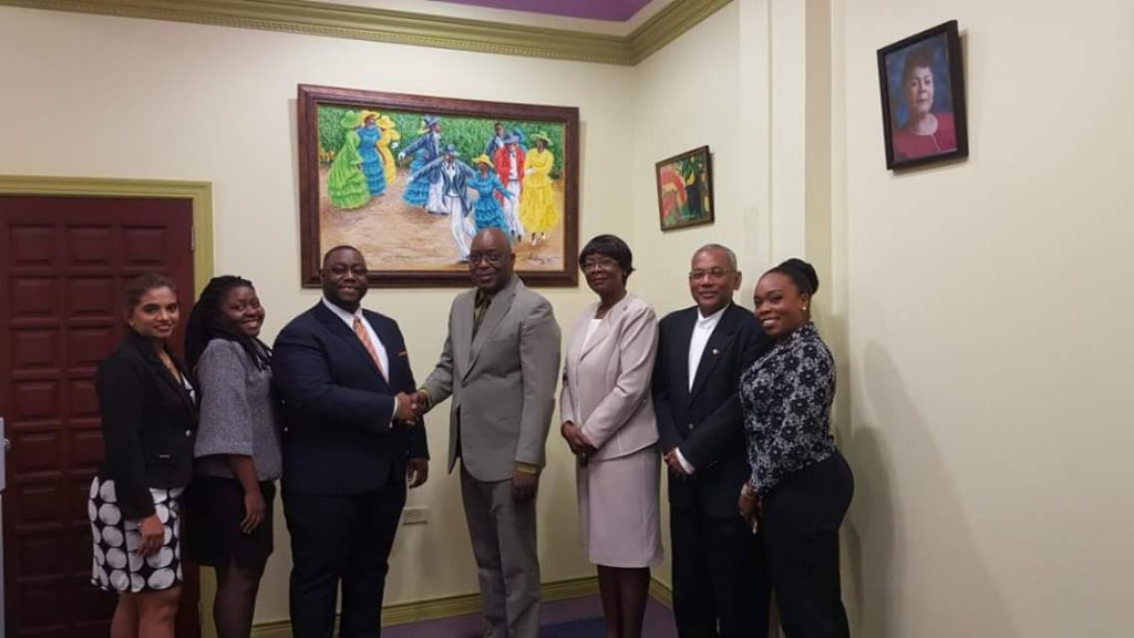 Chief Secretary Kelvin Charles, centre, greets Children's Authority Chairman Hanif Benjamin during a visit by Benjamin and other officials of the Authority to the Chief Secretary's office at the Administrative Complex in Calder Hall. Others in photo, from left are, the Authority's Deputy Director, Corporate Services, Gail Sooknarine, THA Assemblyman Marisha Osmond, Health Secretary Dr Agatha Carrington, the Authority's Board member Mitra Attai and its Investigations and Registry Manager, Rhonda Gregoire-Roopchan.