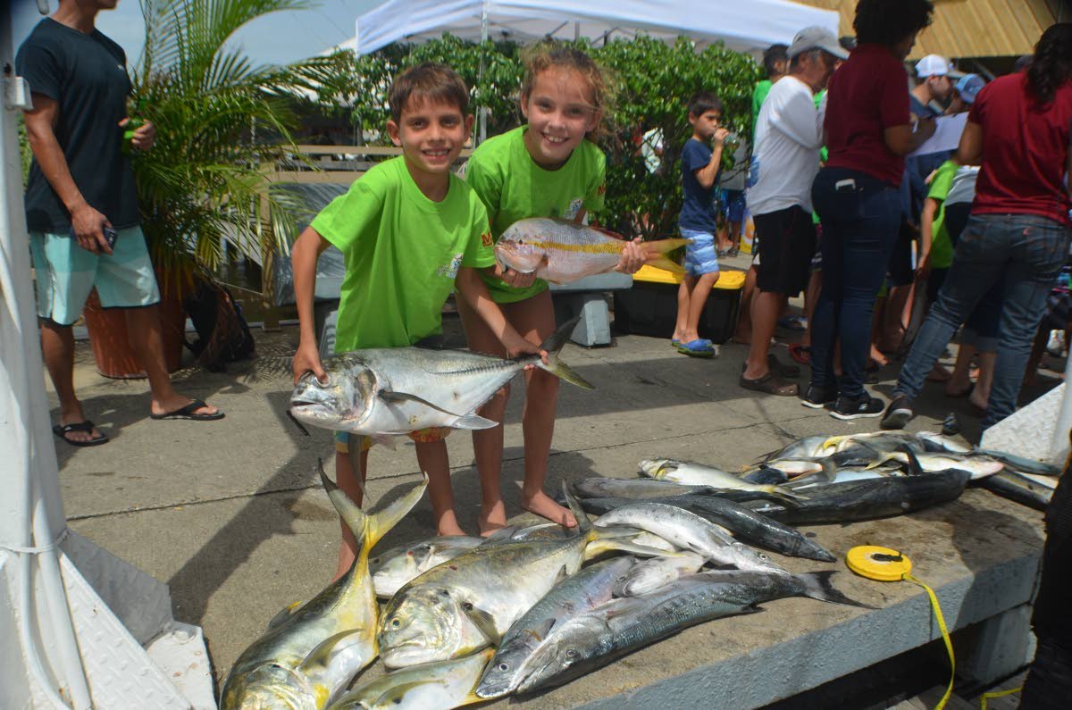 Best Boat winners Jade and Tristan Llanos aboard Team Intrepid show off their catch at the Junior Angler Fishing Tournament on Saturday.  Photo Courtesy – Ronald Daniel