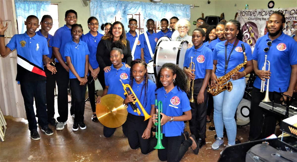 Positive Movement Orchestra's members pose with the newly-acquired instruments.
