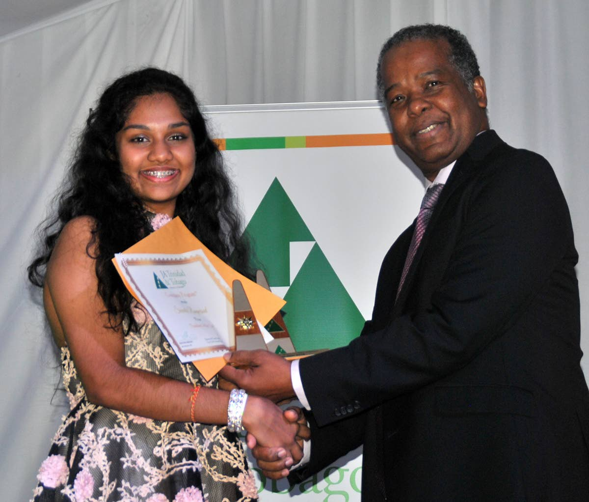 Gerard Jackson, head, government and stakeholder relations, BPTT, presents the award for president of the year to Naparima Girls' Shivala Rampersad, at the Future Unlimited Banquet and  Awards Ceremony at Cascadia Hotel and Conference Centre.