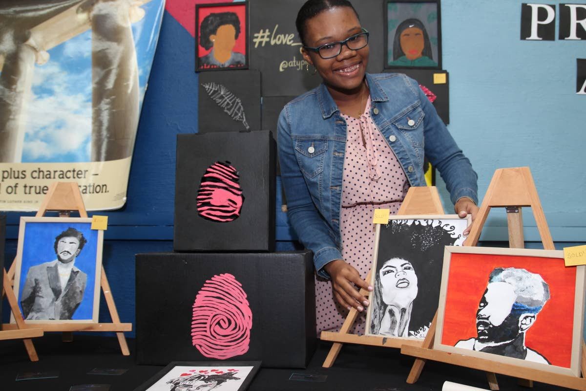 Sian Lezama shows off her wall art designs. Photo by Desiree Sampson